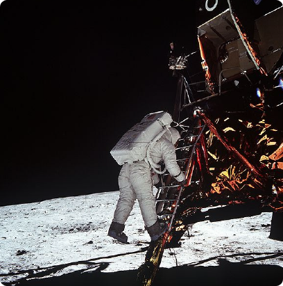 Edwin Aldrin about to set foot on the moon. Photog