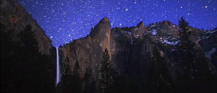 Night sky over 188-meter tall Bridalveil Fall, Yosemite National Park, USA. Wally Pacholka, TWAN (twanight.org)