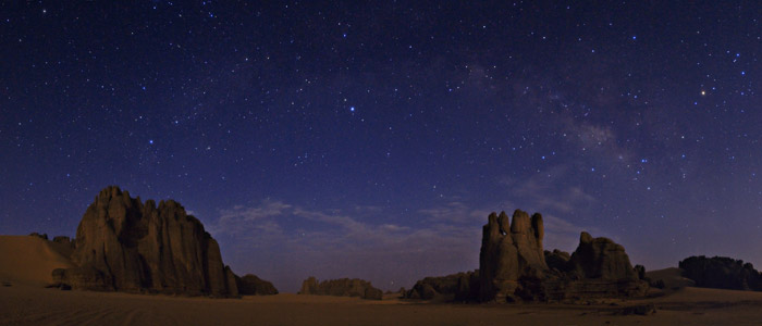 Rising above eroded sandstone cliffs in Tassili National Park, in the heart of the Sahara desert in southern Algeria the celestial menagerie of constellations includes Draco the Dragon, Cygnus the Swan, Aquila the Eagle, and Scorpius the Scorpion. Babak Tafreshi/Dreamview.net